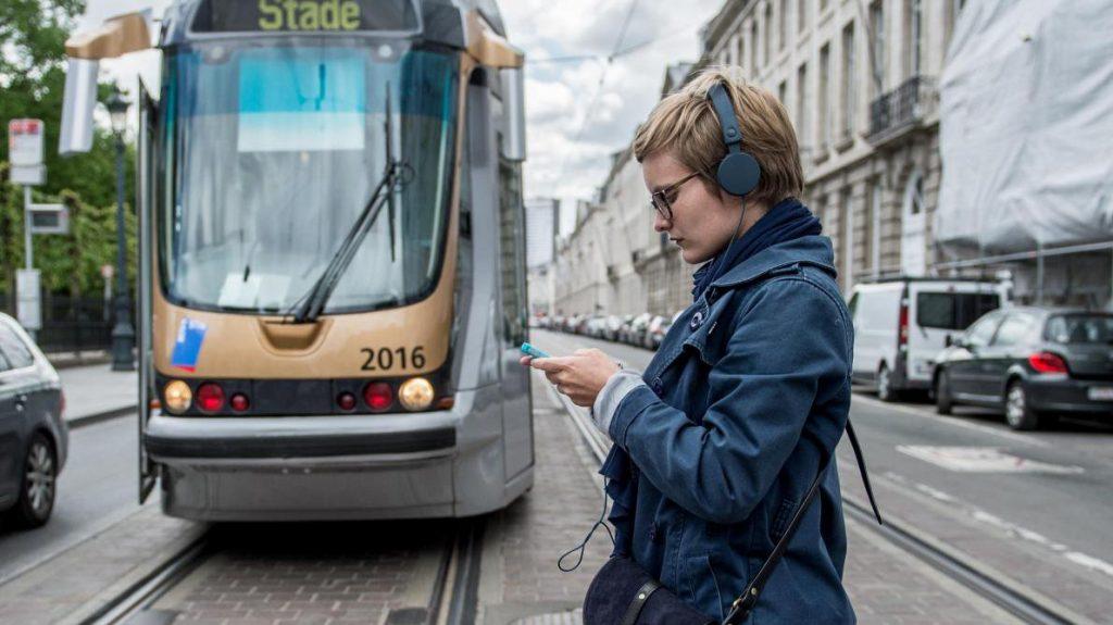 smombies girl walks before a tram